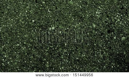 Asphalt, asphalt texture, scabrous asphalt background, asphalt pattern, abstract background, abstract texture, coloured dark asphalt texture, green abstraction, grunge texture