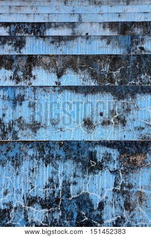 Blue concrete bleachers steps in vertical 3:2 format.
