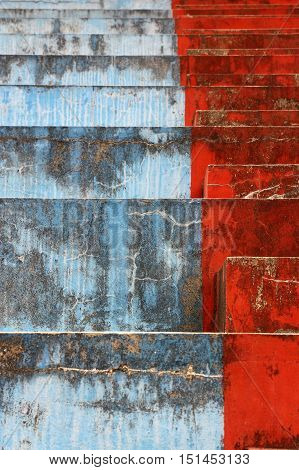 Blue and red bleachers steps in vertical 3:2 format.