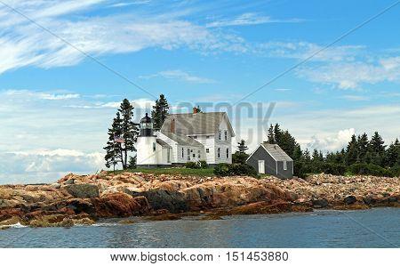 a lighthouse on the rocky coast of Maine