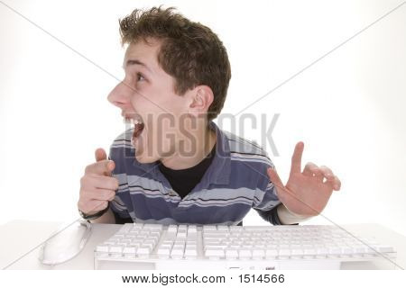 Comical Teenage Boy Showing Computer