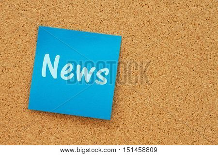 A reminder to get the news message Bulletin board with a blue sticky note with text News