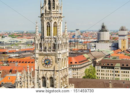 In the foreground the tower of the New Town Hall is a town hall at the northern part of Marienplatz in Munich Bavaria Germany.