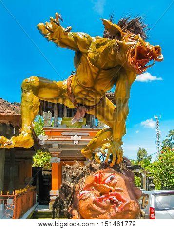 Bali Indonesia - April 12 2012: Balinese monster Ogoh-Ogoh on blue sky background