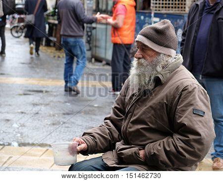 TEL-AVIV ISRAEL - DECEMBER 18 2015: Old beggar in Tel-Aviv. Israel
