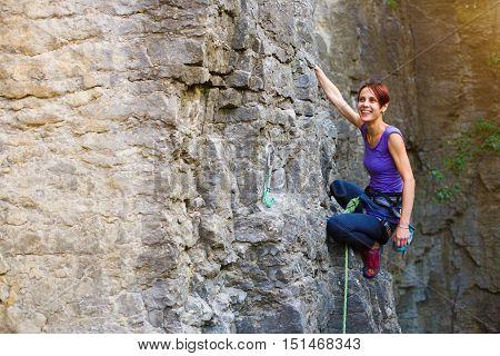 The Girl Climbs The Rock.