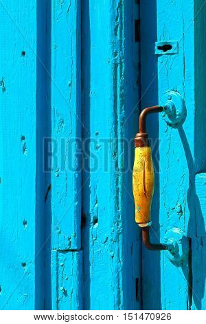 Blue wooden texture doors and yellow handle.