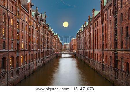 historic Speicherstadt at night in Hamburg with moon