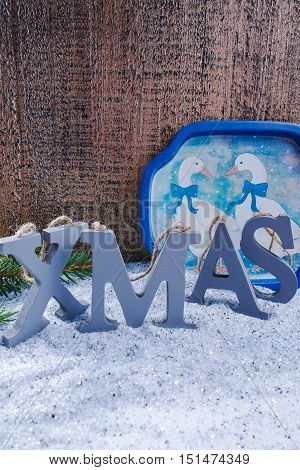 Xmas wooden letters and Christmas ducks on shiny mirrored background