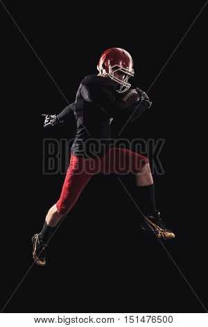 Soccer player on a dark background in vintage style. The classic American game. college Students. It makes the jump