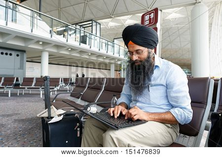 HONG KONG - NOVEMBER 03, 2015: indoor portrait of a man at Hong Kong Airport. Hong Kong International Airport is the main airport in Hong Kong. It is located on the island of Chek Lap Kok.