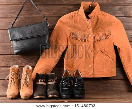 Women's Clothing And Accessories. Brown Suede Jacket, Three Different Pairs Of Shoes And Black Leath