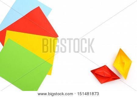 Yellow and red paper boats, origami, paper sheets, color paper sheets