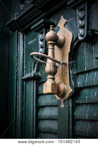 Door hammer of the old wooden door