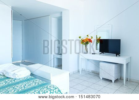 luxury white bedroom with TV and mirrow in apartment.