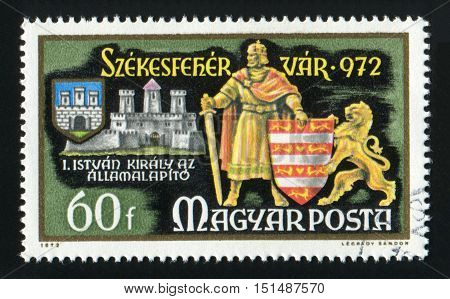 HUNGARY - CIRCA 1972: A post stamp printed in Hungary, shows King Stephen and shield, circa 1972.