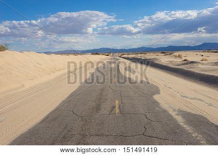 Sand On Empty Desert Road