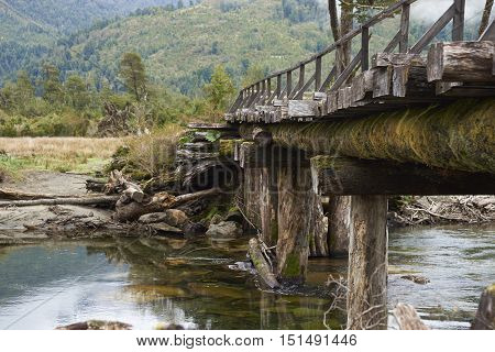 Derelict wooden bridge over the River Risopatron  located along the Carretera Austral  in the Aysen Region of southern Chile.