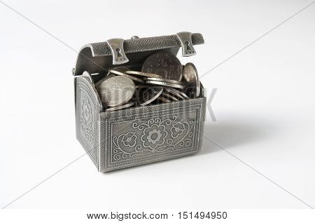 Ajar iron chest with coins on white background