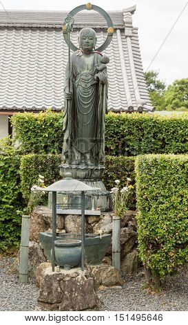 Kyoto Japan - September 15 2016: Kurodani Buddhist Temple displays Bodhisattva Kshitigarbha statue. He is the protector of children and also known in Japan as Jizo or Ojizo-sama.