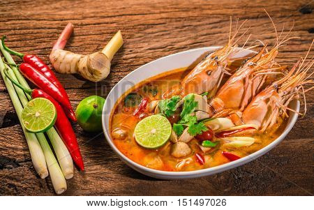 Tom Yum Goong Thai hot spicy soup shrimp with lemon grasslemongalangal on wooden background Thailand Food