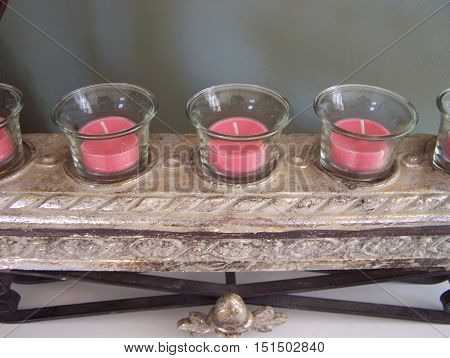 Pink  aroma candles fancy on their stand