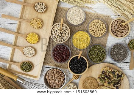 Group of beans and grains on wood table background