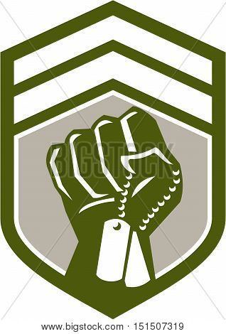 Illustration of a clenched fist clutching holding dogtag viewed from front set inside shield crest done in retro style.