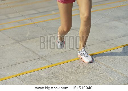 Young Woman Running Outdoor In Morning