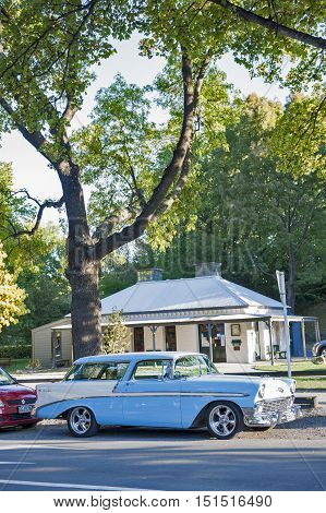 Arrowtown, New Zealand - February 2016: Vintage Car Parking By Roadside Of Historic Settlement Of Ar