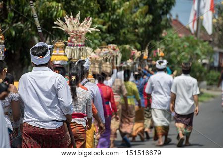 Bali, Indonesia - August 17, 2016 - Balinese Monk And Worshipper At The Temple For Full Moon Celebra