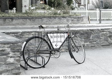 Arrowtown New Zealand - February 2016: Old classic bicycle parking on street of arrowtown