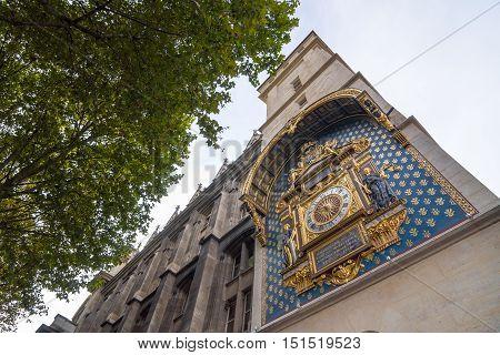 PARIS - SEPT 17 2014: The clock tower or Tour de l'Horloge La Conciergerie Paris France. First public clock in France being installed around 1350-1370.