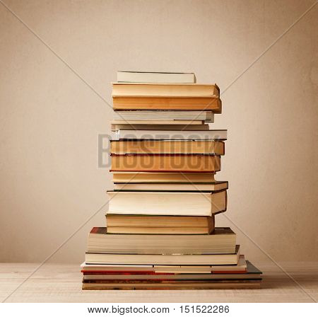 A stack of old books with vintage background