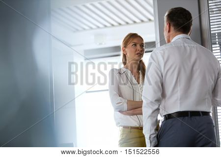 Businesswoman and business man having a very serious conversation in the office