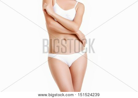 Beautiful slim woman in lingerie. Beautiful female body isolated on white. Beautiful Woman. Perfect Body. Full length portrait of happy young woman in lingerie. Diet, healthy lifestyle.