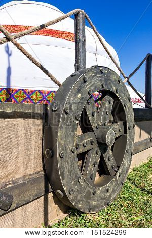 Kazakh yurt with a large wheel on the wagon