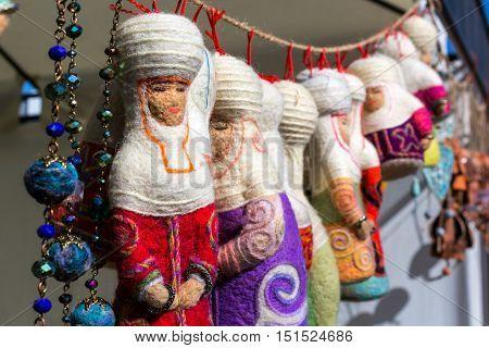 Kazakh felt decorations in the form of dolls