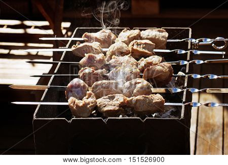 Tasty grilled pork meat on terrace outdoors