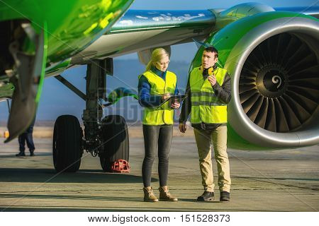 airport staff workers preapre the airplane for flight