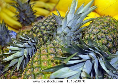 pineapples on display in a big supermarket