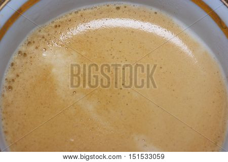 A cup of coffee with caffè crema