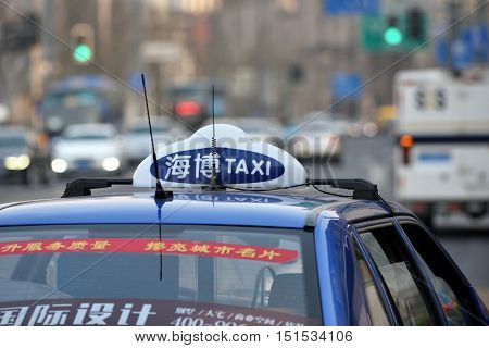 SHANGHAI CHINA - MARCH 25: Taxi car on March 25 2016 in Shanghai China. Shanghai is the largest Chinese city by population.
