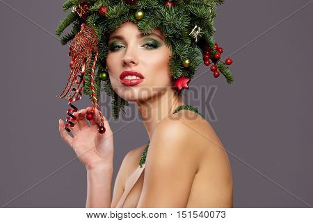 Beauty Girl portrait. Gorgeous Vogue style Lady with Christmas decorations on her head