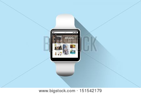 modern technology, internet, object and blogging concept - close up of black smart watch with blog web page on screen over blue background