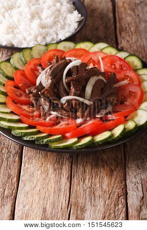 Cambodian Beef Lok Lak With Fresh Vegetables And A Side Dish Of Rice. Vertical