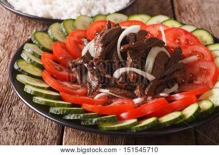 Cambodian Beef Lok Lak With Fresh Vegetables Close-up. Horizontal