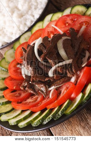 Cambodian Cuisine: Beef Lok Lak With Fresh Vegetables Close-up. Vertical