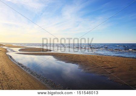 Sea water with small waves in Jurmala. Coast of Baltic sea.