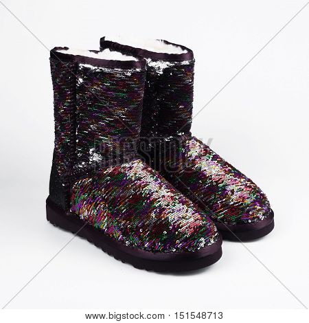 Fashion winter boots in a white background